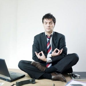 Businessman sitting in Zen Lotus Position
